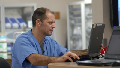 A CoxHealth employee researches benefits on his computer.