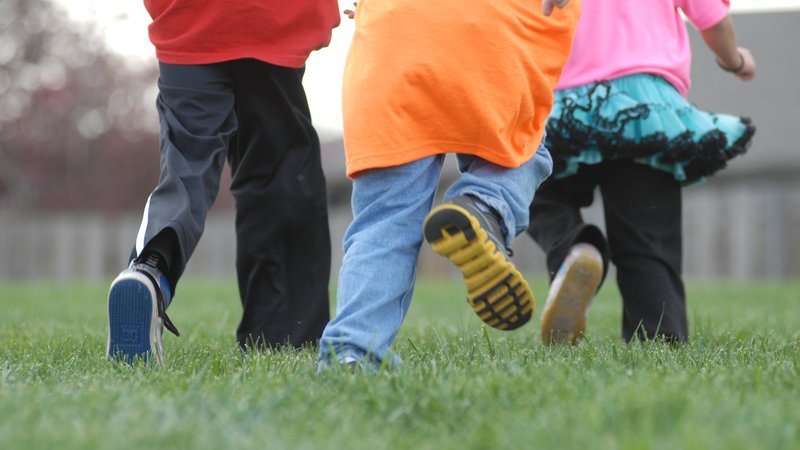A group of kids are running and playing together.