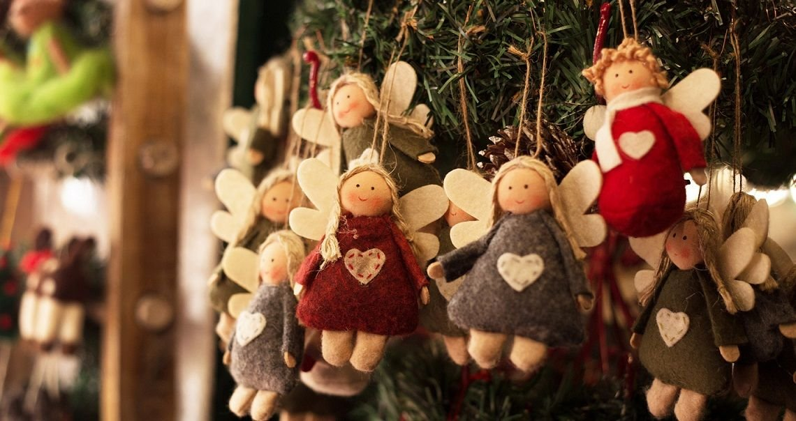 handmade angel ornaments hang on a christmas tree descriptive of the items available at the - When Does Branson Mo Decorate For Christmas