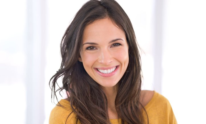 A beautiful woman takes care of her skin, with the help of the dermatologists at CoxHealth.