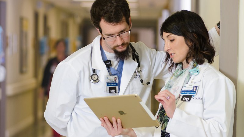 Cox Family Medicine residents and faculty discuss patient care.