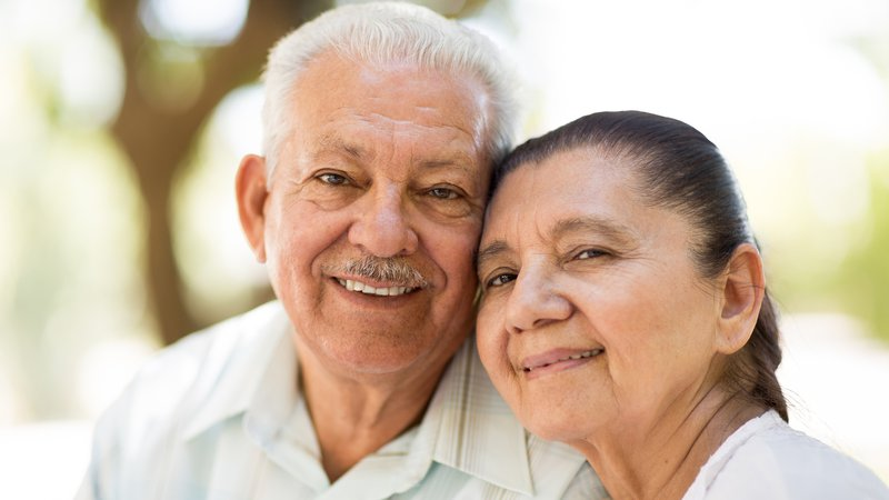 A smiling senior couple.
