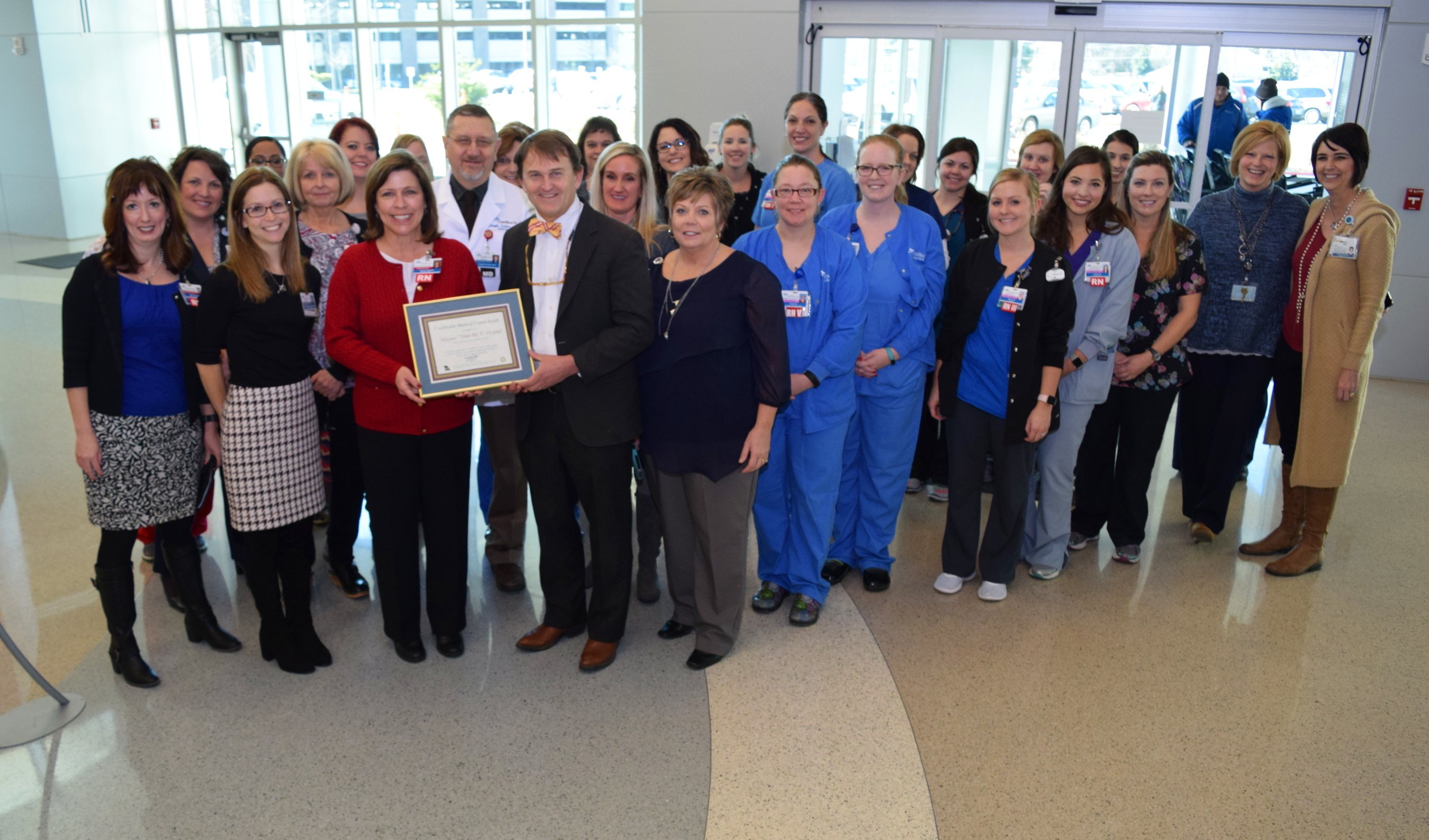 CoxHealth's team poses with its Show-Me 5 certificate.