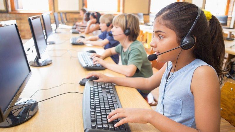 Children work on computers at school.