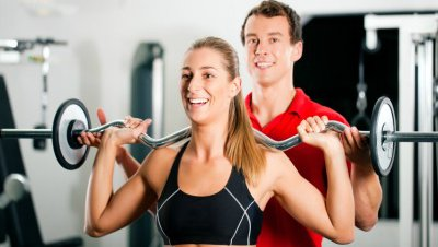 A personal trainer offers advice to a client.