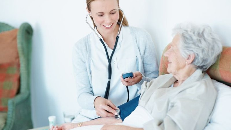 A doctor checks the vital signs of a patient.