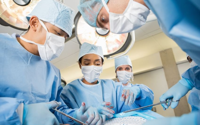 CoxHealth doctors preform heart surgery on a patient.