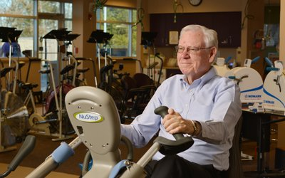 Bob Simmons is pictured exercising on a stationary bike.