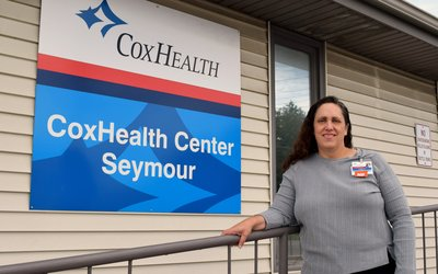 Jeanne Rodman stands in front of CoxHealth Center Seymour.