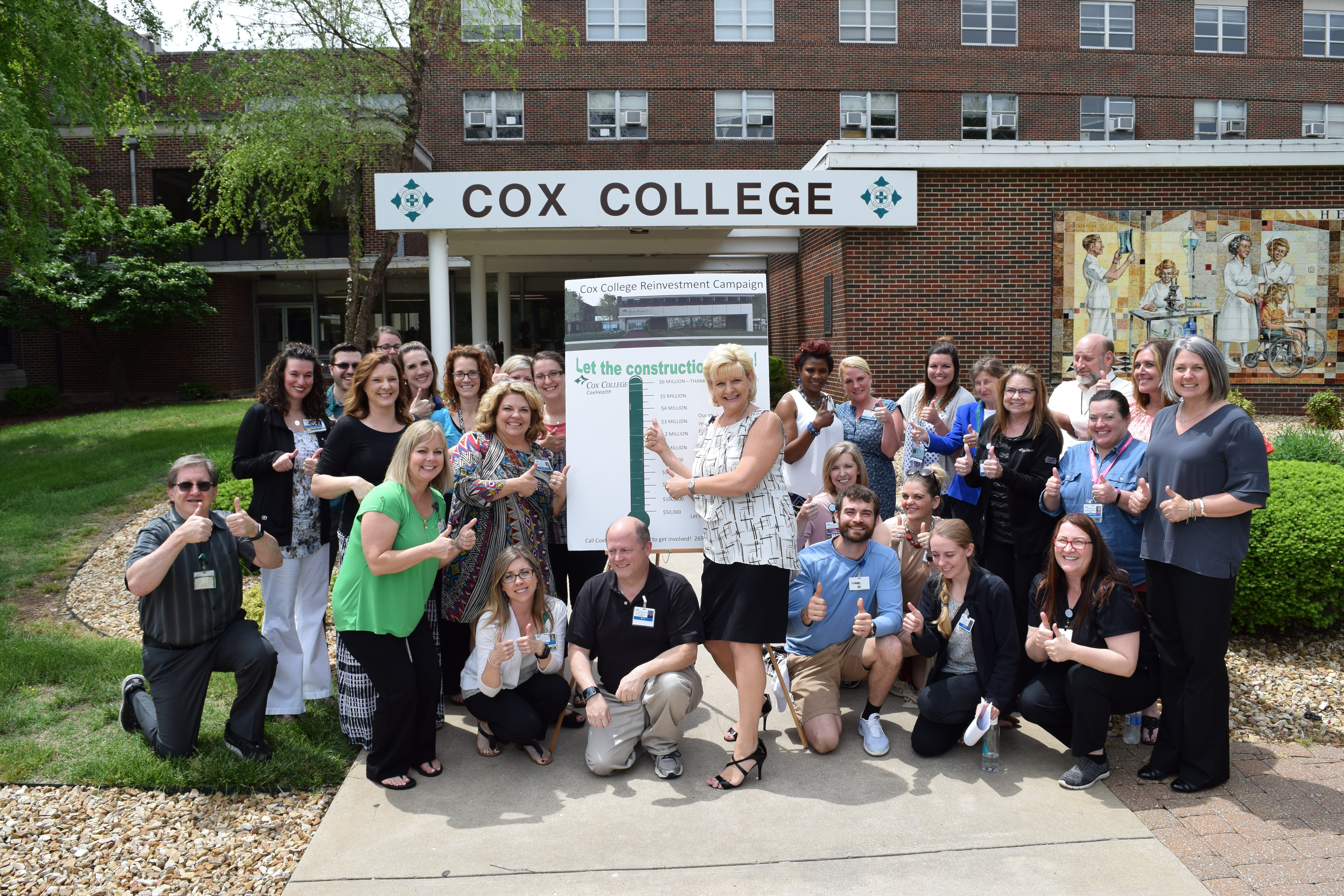 Cox College faculty and staff gather to celebrate the fundraising campaign's completion.