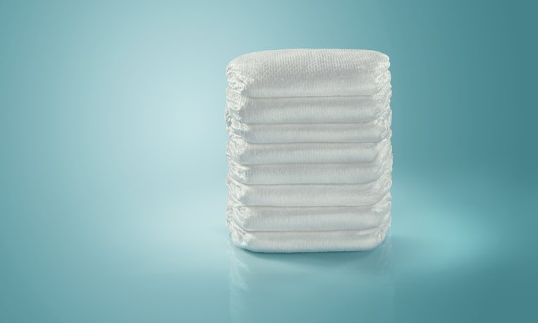 A stack of diapers is pictured.