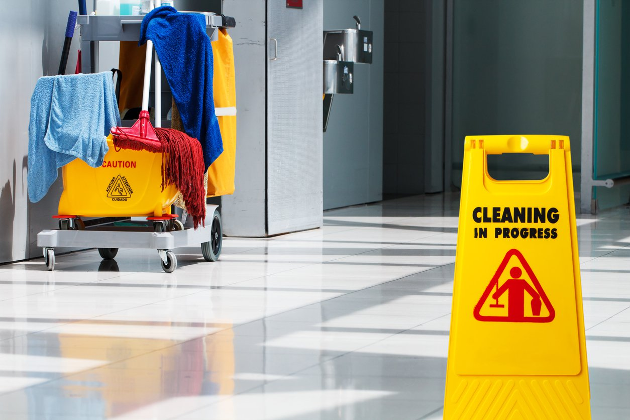 An EVS sign and cart sit in a hallway.