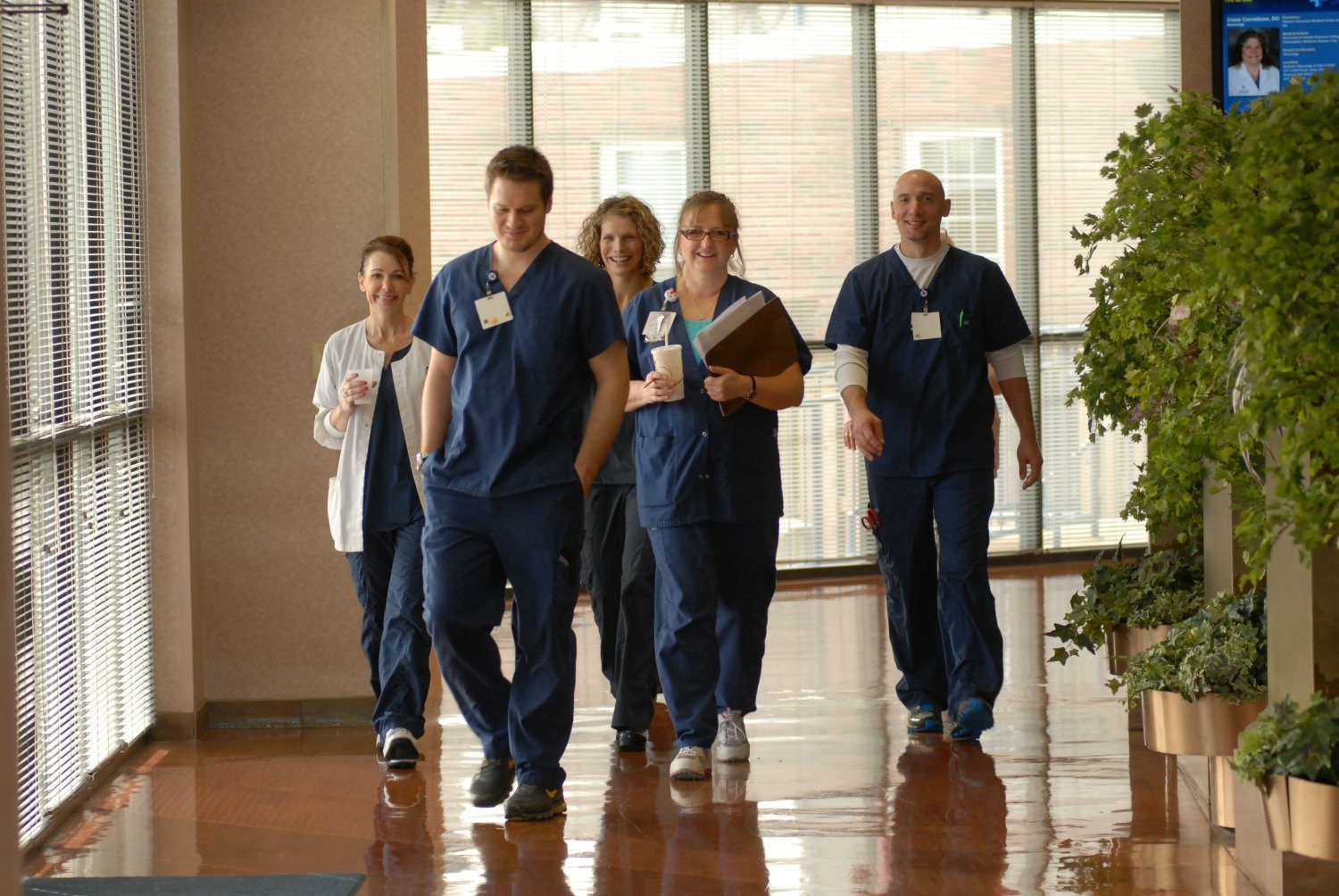 CoxHealth employees walk down a hall.