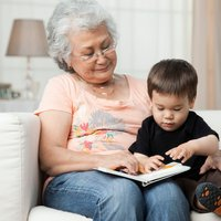 A grandmother reads to her grandson and attends CoxHealth's Grandparenting classes.