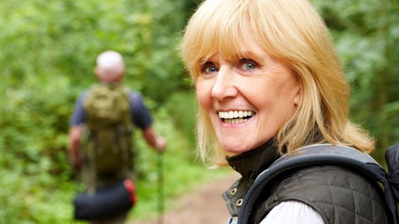 A woman is hiking after receiving heart care at CoxHealth.
