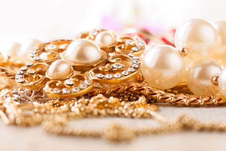 A pile of golden jewelry is purchased at CoxHealth's $6 jewelry sale.