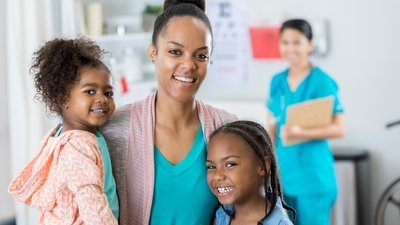 A mother and her daughters leave CoxHealth Pediatric Urgent Care in Springfield, Mo.