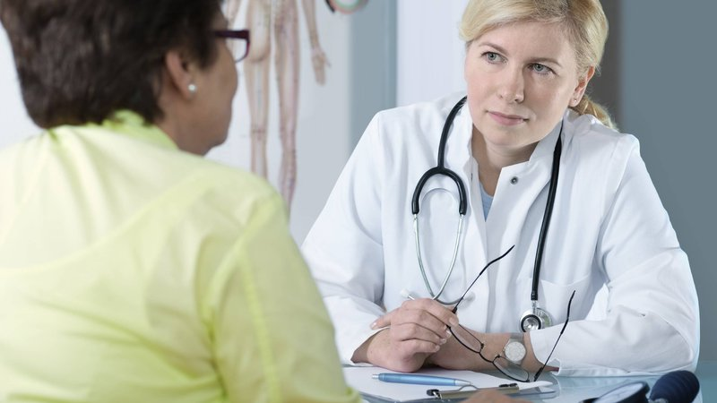 A CoxHealth physician discusses treatment options with her patient.
